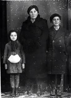 Holocaust survivor; Elie Wiesel (far right) with mother and younger sister Tzipora in a archive photo taken before Elie was transported to the death camps. His mother and sister did not survive the war.