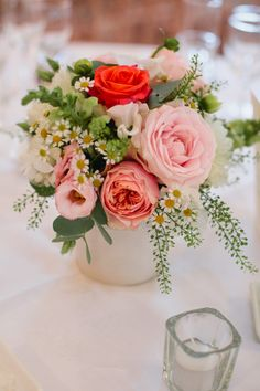 flowers in pails served as aisle decoration for the ceremony and doubled as centerpieces for the wedding dinner! David Austin Roses, roses in dark coral, sweet avalanche, lisianthus in white and pink, white sweet peas, Matriaca daisies, white dahlias, white snap dragons, green bells (flowers by @Clare Robinson , photo by @Tara Hannon Coonan)