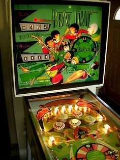 the beatles pinball- not really - the glass header has been changed - but the Williams pinball game copied the Beatles and took advantage to market their machine and place it inside pizza parlors and bowling alleys