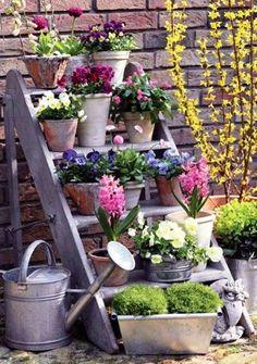 Re-paint shelves for party - Lovely garden decor