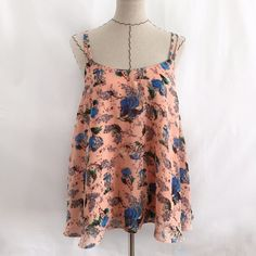 Floral tank top FLOWY tank top. Length is approx 20 inches from strap. Approx 18 inches from lowest point in the scoop neck. Size is listed as small but could possibly fit a medium since it is so flowy. Brand is love Sadie Urban Outfitters Tops Tank Tops