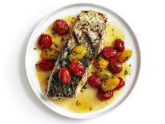 Grilled Bass with Buttery Tomatoes recipe from Food Network Kitchen via Food Network