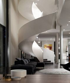 Glamour and luxury defined in this incredible Aussie villa ...amazing sculptural staircase