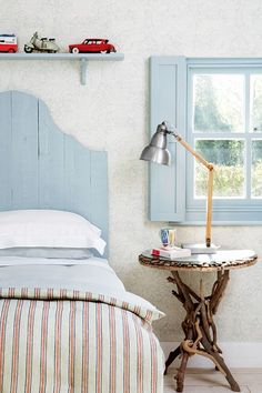 See all our stylish bedroom design ideas. Including this New England style bedroom with faded stripes and painted wood.