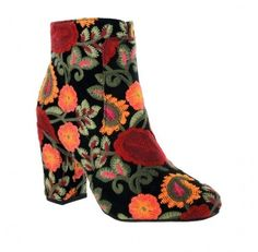 These boots are on 🔥🔥🔥!  Add a colorful flair to your next ensemble with the MIA Rosebud ankle booties. Designed in a floral brocade fabric, this stylish pair features a vivid embroidered motif, a pointed toe set on a sturdy, stacked heel and finished with a hidden side zipper closure. #MIAsays show the MIA Rosebud booties off with miniskirts and knee length dresses.