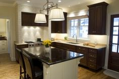 Dark kitchen cabinets can have a modern, industrial appeal.Bright, sunny kitchens with pastel trim or country curtains don't appeal to everyone, so if you