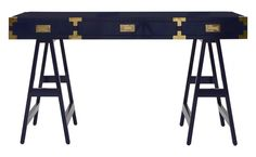 "It would be a pleasure doing business at our Huck Desk. Huck borrows from the campaign style of British Colonial furniture, but distinguishes itself with a high gloss lacquered navy finish. Fit with classic brass drawer pulls, decorative corner brackets and trestle base, Huck marries heritage with haute for a statement making workspace. 	    •55""W x 23.75""D x 30.5""H  •mahogany  •high gloss navy lacquer finish  •brass drawer pulls and hardware"