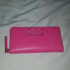 Kate Spade Neda Wellesley Wallet All around zip wallet. 12 card slots two bill sections. Pocket in the back. Zip inside for change. Light pink fabric inside. Cabaret pink color of leather. Sturdy wallet. Perfect for all your cards and receipts. New never used. Same color as card holder. Gold accents. Discount when bundled. Also have a callie wallet in a pink shade. Open to reasonable offers. kate spade Bags Wallets