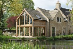 An oak wood and glass extension in Cirencester, Cotswolds. An oak wood and glass extension in Cirenc Oak Framed Extensions, House Extensions, Style At Home, Stone Patio Designs, Cottage Extension, Oak Framed Buildings, Oak Frame House, Glass Extension, Building Extension