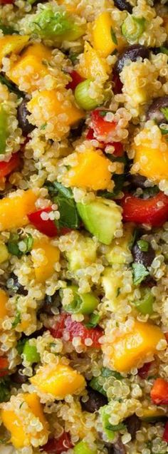 Mango Black Bean and Avocado Quinoa Salad ~ It's brimming with so many fresh and delicious flavors and it's totally satisfying... Not to mention it's perfectly healthy too.