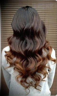Or, there's the reverse red-head. Brown usually has hints of auburn in it, so play them up with beautiful reddish-brown ends.Image via Pinterest
