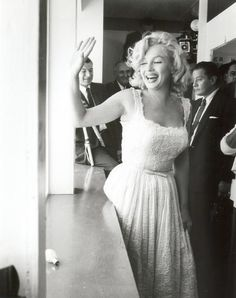 Marilyn Monroe attends the inauguration of the Sidewalk Superintendents Club at the new Time-Life Building in Manhattan, July 2nd 1957.