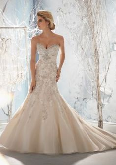 Beaded Fit and Flare Wedding Dress. Usually I go for pure white, but I would let it slip for this dress