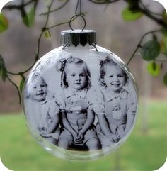 Photo printed on vellum and inserted into a glass ornament- I am making this next Christmas for sure!!!!  Have photos in mind for this too!