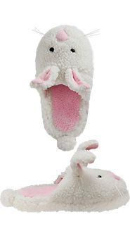 2 Cute!!! Polyester terrycloth. Rubber sole has bunny paw imprint. With button eyes, whiskers, poseable ears, and a puffy cottontail.