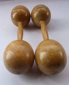 These are a lovely pair of old wooden dumbbells. I have two pairs in my store - this smaller pair - and a larger pair. This pair is much smaller and is 1/2 lb in weight. They are in lovely antique condition with a beautiful honey colour to the wood. A few little scuffs commensurate with age and use - but not disfiguring. The shape is very sculptural and they made great display items for a coffee table or in your collection of gym equipment. This pair is 8 inches in length. HAPPY TO POST…