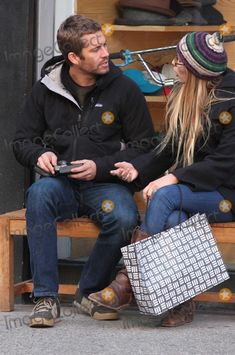 NYC  02/17/09 EXCLUSIVE: Paul Walker and his girlfriend  Jasmine Pilchard-Gosnell, sitting on a bench, and stopping to take pictures while shopping  in SOHO with unidentifed male Digital Photo by Adam Nemser-PHOTOlink.net
