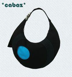 Ludic un  sac original, un design moderne!  Ce sac est toute en rondeur, il epouse votre silhouette.  C'est un rond parfait.    UNE GRANDE POCHE INTER