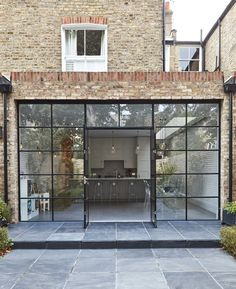 We are so in love with Crittall style windows and doors! Perfect in any home. We are so in love with Crittall style windows and doors! Perfect in any home. House Extension Design, Glass Extension, Rear Extension, Crittall Extension, Kitchen Extension Glass Doors, Kitchen Extension Exterior, Brick Extension, Cottage Extension, Extension Ideas