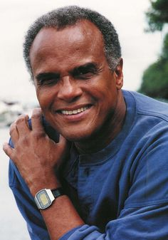 Harry Belafonte. Unique voice, talented and very sexy. He can sing the 'Banana Boat Song' at my table any time.