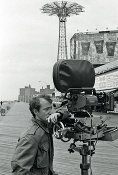 """Actor / director Woody Allen filming a scene at Coney Island, New York for his 1977 film """"Annie Hall""""."""