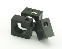 Jose Antonio Moralejo - Rings Materials: slate, resin, natural pigments, gold and lead Dimensions: 33 x 33 mm