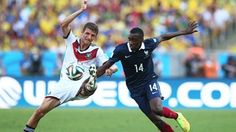 Blaise Matuidi of France challenges Thomas Mueller of Germany