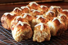 This classic hot cross buns recipe is mixed and kneaded in the bread machine. Just shape, bake, and drizzle the crosses with the vanilla icing. Add currants, raisins, or chopped dried fruit to the hot cross bun dough.