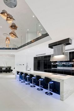 Metallic finishes and contemporary shapes give this ultra modern kitchen a cosmos, sci-fi feel