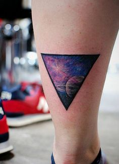 Chronic Ink Tattoo - Toronto Tattoo Saturn and galaxy tattoo in a triangle, done by Karen.