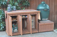 """BIg Green Egg Storage & Stand--I *so* want to add this to the back yard """"kitchen."""" A girl can dream. Big Green Egg Outdoor Kitchen, Big Green Egg Table, Big Green Egg Grill, Green Eggs And Ham, Kamado Grill, Kamado Joe, Big Green Egg Accessories, Egg Storage, Bbq Table"""