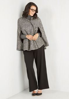Brunch with Boston's most elegant crowd, draped in this tasteful tweed cape. Classic black and white hues pattern the silhouette of this unlined, zippered layer, while trimmed arm openings allow you to carry your clutch as you stroll the cobblestone toward your dining destination.