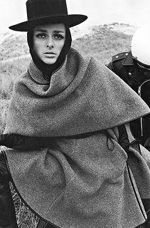 Agneta Darin in grey cashmere poncho trimmed in leather by Bonnie Cashin, photo by Francesco Scavullo, Harper's Bazaar, 1966