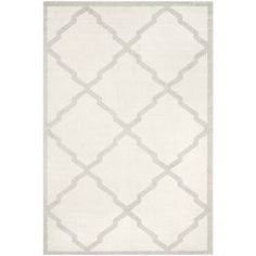 """Anchor your dining set or living room seating group in chic style with this understated rug, showcasing a classic trellis motif in light grey and beige.  Product: RugConstruction Material: PolypropyleneColor: Beige and light greyFeatures: Power-loomedPile Height: 0.25"""" Note: Please be aware that actual colors may vary from those shown on your screen. Accent rugs may also not show the entire pattern that the corresponding area rugs have.Cleaning and Care: Professional cleaning recommended"""