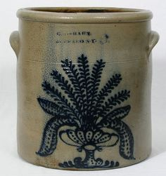 6 gallon W. Braun crock with a large collection of ferns in an urn.