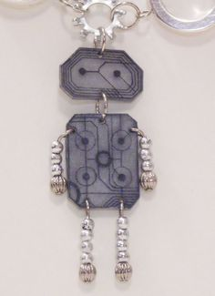 shrink plastic robot - with beads. Could do people, animals etc