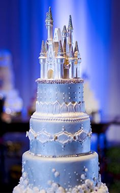 This Cinderella Castle wedding cake will command attention at your     Princess inspired wedding cake complete with a castle cake topper at the  Disney s Fairy Tale Weddings
