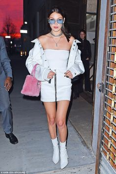 Always flaunting it! Bella Hadid, 20, showed off her stellar body and endless legs in a white mini dress while heading to a photoshoot in New York City on Wednesday