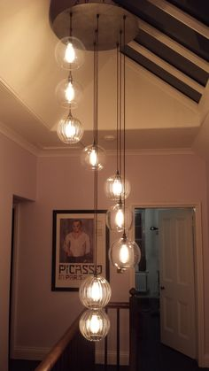 Hereford Staged Cluster, 9 lights Cluster Chandelier- Fritz Fryer - All For Decoration Stairway Lighting, Hall Lighting, Rustic Lighting, High Ceiling Lighting, Hanging Ceiling Lights, Hanging Lamps, Staircase Lighting Ideas, Industrial Hanging Lights, Club Lighting