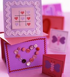 Sealed with a Kiss Cards -- This year, skip pricey store-bought cards. Instead, purchase plain card stock, patterned paper, pretty buttons, and ribbon, then let the kids go to town to create more personal Valentine's wishes.