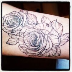 Roses are red, violets are blue, here's a pic of my new tattoo.  I had this done on the inside of my left bicep by Yoshio Honjo in Sydney, Australia. It represents me and my sister - who is my best friend and gorgeous. I wanted something simple and in black and white.