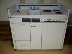 Wow. This is being offered on ebay right now. Well, the auction ended without the reserve being met. It's old, it's all electric, so it might be too big a drain for a Tiny House. Kind of cute.   Vintage Dwyer Kitchen Kitchenette Stove Refrigerator Sink Cabinets Model E48 | eBay
