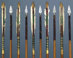 Ottoman arrows, 1550 to 1750,  pine shafts, red, blue and green polychrome paint, with gold flowers and vine decoration. metal filament winding, triple white plumage, forged iron tips, 73.8 cm (length), 25 g (weight).  Museum Hessen Kassel.