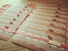 Coral wedding invitations before they are all tied X
