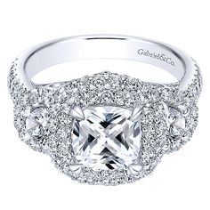 Absolutely gorgeous, would have been my first choice if I hadn't found the pear shaped three stone with halos from NY. Love the details under the stone, I would love if that design could replace the bands of diamonds under the center stone on the NY ring.