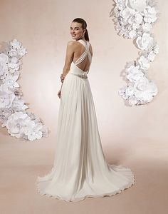 Sweetheart / Wedding Gowns / Style #5994 / Available Colours : Ivory/Silver, White/Silver - A ruched sweetheart halter neckline accented by a beaded applique on the bodice and a cummerbund in crinkle chiffon on a pleated A-line skirt. The back has a criss-cross with a sheer beaded applique at the waist with buttons that cover the back zipper. This style has a sweep length train (back)