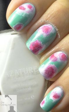 Holly from The Trendy Nail nails this abstract tie-dye look with three different nail colors and a little nail polish remover. #NailArt #Spring
