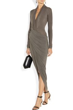 DONNA KARAN Draped wrap-effect jersey dress $1,895  Easy glamor was key in Donna Karan's fall collection. Draped across the torso into a wrap-effect skirt, this jersey dress beautifully contours your body without restricting movement. Wear it as seen on the runway, with neutral accessories.  Shown here with: Tom Binns earrings, Maiyet ring, Pamela Love ring, Givenchy shoes, Alexander Wang bag.