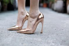 Rose Gold Christian Dior heels. I love the cut of the heel. That angle is wild.