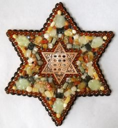 """The medium (17 1/2"""" in diameter) star of David with hoshen in center is surrounded by stones from the 12 tribes of Israel."""